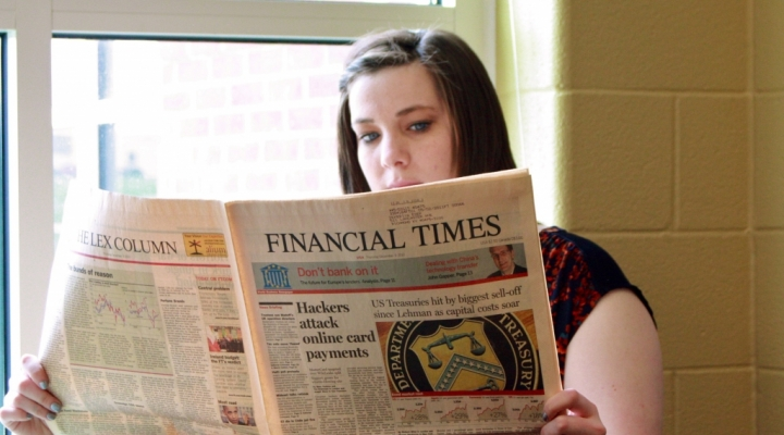 Finance student reviews the day's news reports